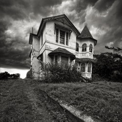 A derelict old house on top of a hill