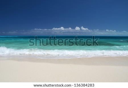 A desert beach of Little Exuma, Bahamas - stock photo