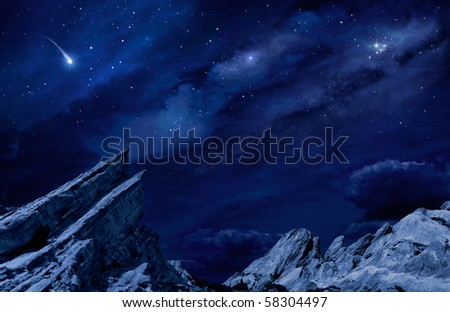 A desert landscape at night with moonlight and stars.