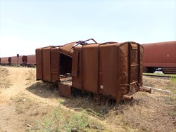 A deserted rusted wagon at a yard ground