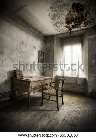 A desk in a creepy atmosphere, broken ceiling and moody light.