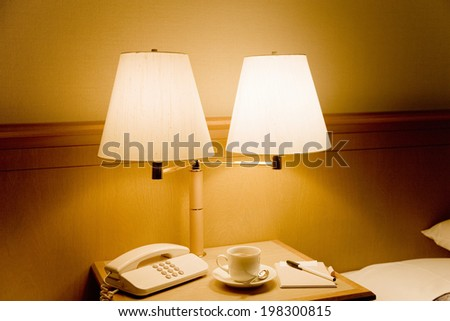 A Desk Lamp And Coffee