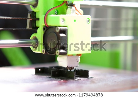 A desktop 3d printer in the laboratory for prints a structure from a polymer
