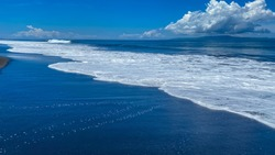 A desolate ocean shore with rolling waves. Background banner panorama