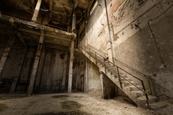 a desolate old industrial building inside, stair