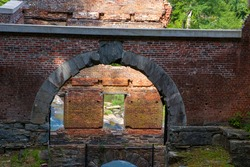 A destroyed Cotton Mill structure from the civil war in Sweet Water Creek Georgia.  Arch, pillars, walls, all of stone