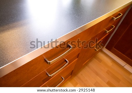 A detail close up image of a stylish kitchen counter and drawer.