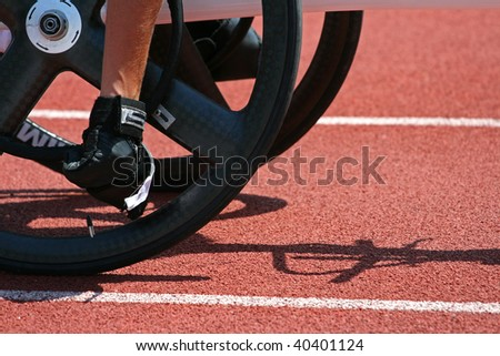 A detail from a male athlete getting ready for a wheelchair race