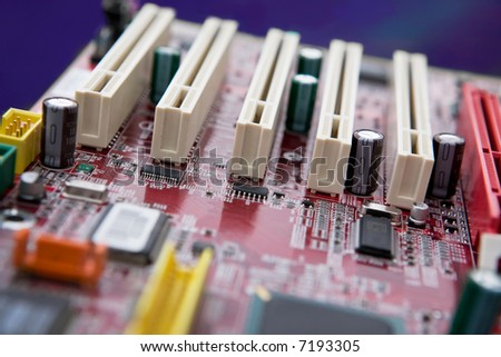 A detail image of a mother board with PCI slots. NOTE: Shallow depth of field is used to create an effective background image. - stock photo