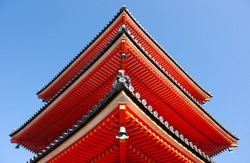 A detail of a corner of tower at the bright red colored Nishimon Temple at Kiyomizudera Temple in Kyoto in Japan