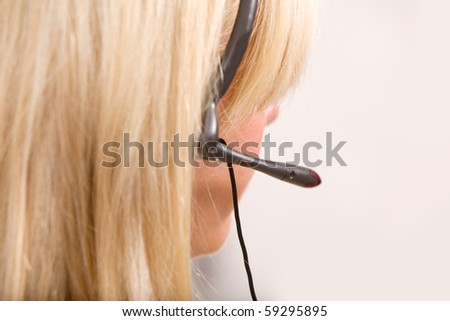 A detail of a receptionist with a headset