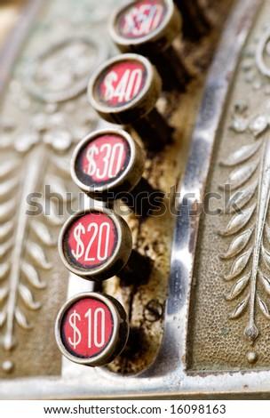 A detail of a vintage dirty cash register