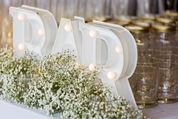 A detail of wedding decoration display with bar electric sign, glass