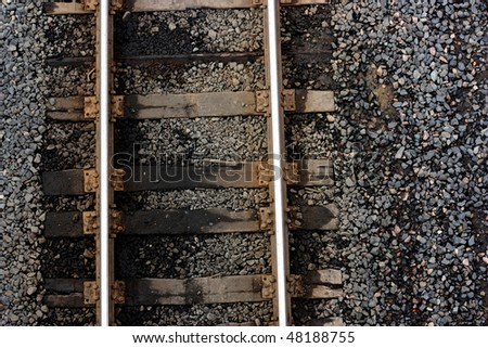 A Detail Shot of the Rich Textures of Railroad Track Ties, Steel, and Gravel