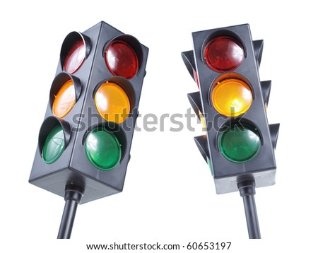 a detailed miniature of the traffic light, made by plastic complete with red, orange, and green  light in it