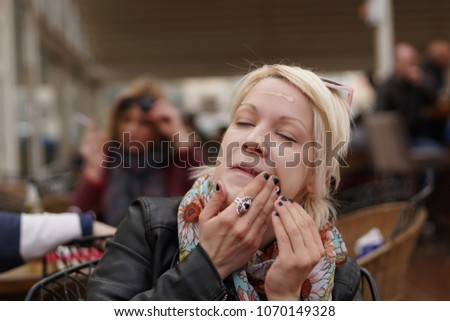 A detailed photo of a girl doing her make up #1070149328