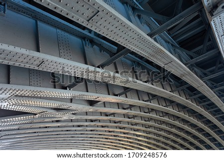A detailed view of the metallic infrastructure below the modern Blackfriars Bridge.