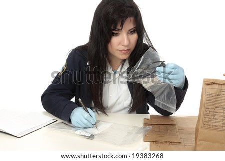 A detective with evidence from a crime scene.  Properly collected and preserved evidence can establish a strong link between an individual and a criminal act.