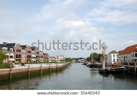 A development of new modern homes with view on the water is designed to fit in perfectly with the old historic homes in the dutch city Zierikzee