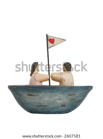 A devoted couple in a sailboat with a heart flag
