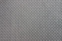 A diagonal pattern on gray metal