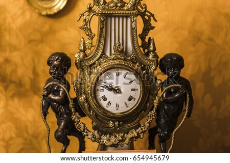 A dial of an old antique clock, a vintage background. Concepts of antiques and time #654945679