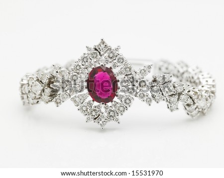 A Diamond bracelet  with red ruby in the center