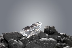 A diamond in a pile of coal shows the evolution of a precious gem.