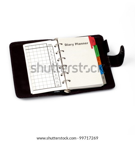"A diary opened at page of ""Diary planner"". Isolated on white background"