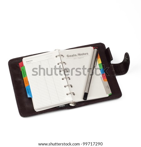 "A diary opened at page of ""Notes"" with pen that lay on it. Isolated on white background"