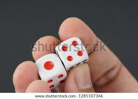 a dice on a palm of the hand #1285107346