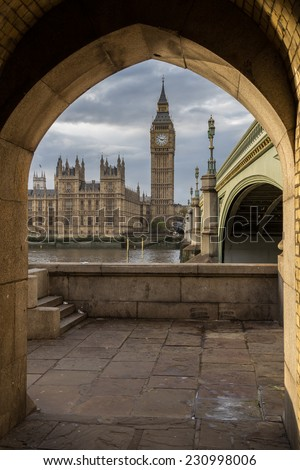 A different view of Big Ben, taken through an arch on the opposite side of the river and framed by a stone arch. Upright format