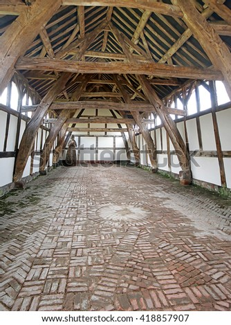 A digital anisotropic illustration of the 14th century cruck barn at Arley Hall, Cheshire, UK