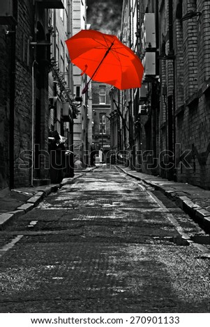 A digitally constructed painting of a colorful umbrella in a dark back street alley