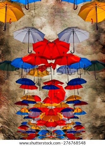 A digitally constructed painting of colorful umbrellas against a grungy background