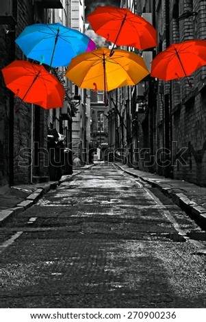 A digitally constructed painting of colorful umbrellas in a dark back street alley