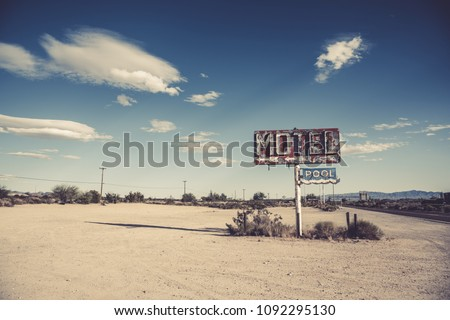 A dilapidated, classic, vintage motel sign in the desert of Arizona Сток-фото ©