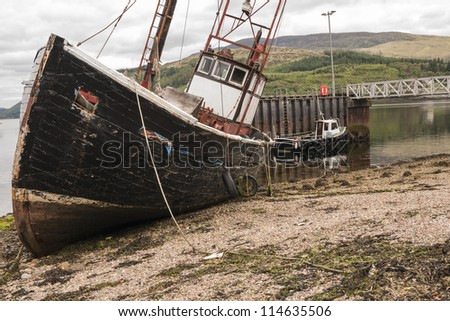 A dilapidated rotting trawler towed in to Corran from its partially sunken position approx. 1 mile further up Loch Linnhe.