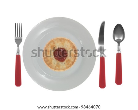 A dinner setting with cutlery and plates - stock photo