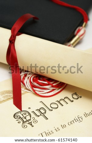 A diploma and grad hat represent a high achieving student.