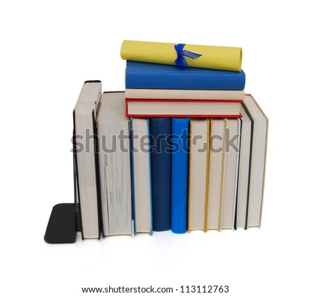 A diploma with blue ribbon over blue books. Isolated on white.