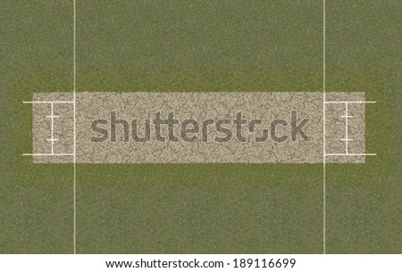 A direct top view of the layout of a cricket pitch set up on grass