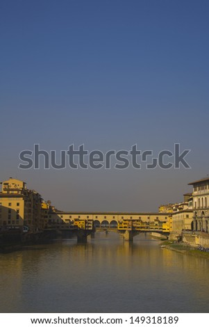 A direct view of the Ponte Vecchio Bridge, looking down the river Arno in Florence, Italy/ Ponte Vecchio Bridge, Florence, Italy