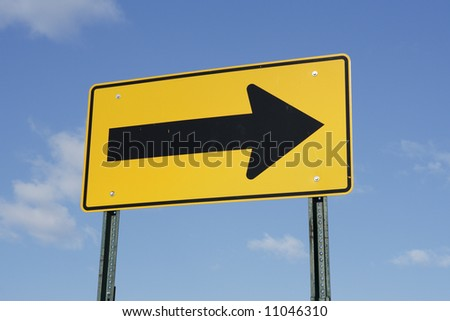 A directional arrow street sign pointing to the right.