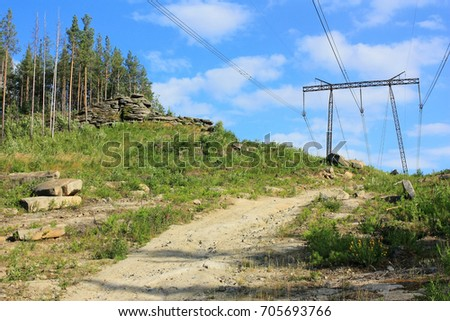 A dirt road in the mountains #705693766