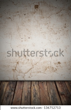 a dirty room with a wooden floor