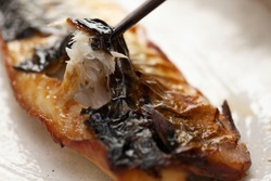 A dish of grilled salted mackerel