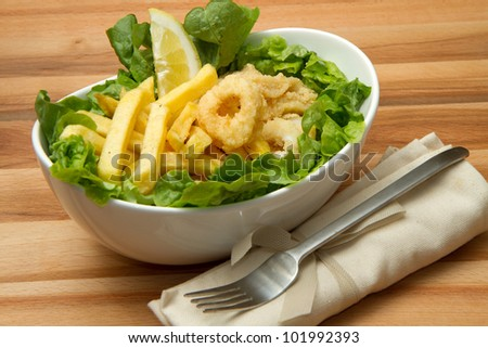 a dish with calamari fried and potatoes