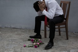 A disheartened man in a suit, broken-hearted after being rejected