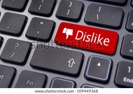 A dislike message on enter keyboard for anti social media concepts.